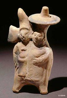 Justin Kerr image: Image:  6646  File date:  2001-02-25  Caption:  Jaina Whistle  Description:  Maya. Jaina. clay. length 9.0 cm. Double figure. May represent a marriage portrait.length 9.0 cm.