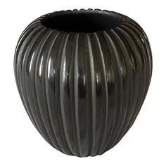 This is a black melon vase by the artist Miana Pablita of Santa Clara. The vase is signed on the bottom. It is in good Condition. Pueblo Pottery, Hand Thrown Pottery, Native American Pottery, Santa Clara, Acanthus, 1980s, Stoneware, Art Nouveau, Vases