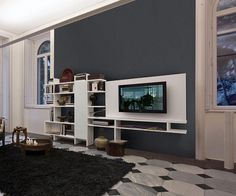 King Furniture Our Set Systems wall units have unlimited possible configurations and can be wall mounted or free standing. Includes a rotating TV panel. Take a look now.