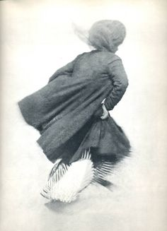 jacques-henri lartigue, guitty (marguérite bourcart) playing on the tideline, la barre de l'adour, biarritz, 1905