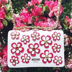 """""""Nothing puts spring in our step like a shiny new handbag """" - Photo by Nordstrom Toronto Eaton Centre - www.moschino.com"""