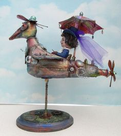"""Rachel's Flying Machine PDF Class on CD  Susan Barmore's design, Rachel's Flying Machine, features a little Steampunk lady (8"""" tall) flying a bird shaped plane (12"""" long).  You will have great fun making this little lady and embellishing the flying machine!  Originally an online class the CD consists of 3 lessons in PDF format."""