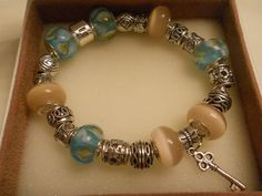 I'm selling Sterling Silver 8.0 in European Charm and Beaded Bracelet in a soft green and Tan! Very Pretty! - $72.99