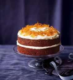 Paul Hollywood's simple carrot cake recipe is made with pecan nuts, cinnamon, ginger and topped with a cream cheese frosting.