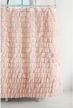 Such a cute girly ruffly shower curtain. Urban Outfitters.