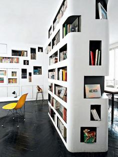 Walls of built-in colorblocked nooks for your favorite books