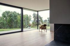 Skapa updates prefabricated Norwegian seafront house with glass walls