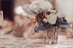 winter wedding centerpieces mecury,winter centerpieceswith pine cones