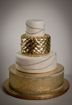 Glamorous wedding cake with layers of gold and white. Beautiful. Classy. Alternative wedding cake. Perfect for a beach or mermaid wedding!