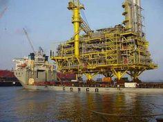 ship transporting 11,000 ton oil platform