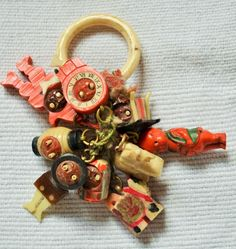 Nine Japanese Celluloid Kobe Charms on Original Bone Ring 1920s 30s Pop Out Eyes