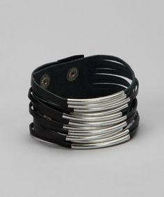 Edgy, street-smart and effortlessly cool, this bracelet says it all! Silver-plated hardware brings a gleaming feminine appeal to this black leather accent.