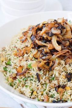 Mujadara: Sweet Spiced Lentils and Rice – West of the Loop Mujadara is a beloved Middle Eastern spiced rice and lentil dish. Works both hot and cold and as a veggie main dish and a side. Vegan and Gluten-Free! Lebanese Recipes, Indian Food Recipes, Whole Food Recipes, Cooking Recipes, Ethnic Recipes, Lentil Recipes, Vegetarian Recipes, Healthy Recipes, Lentil Dishes
