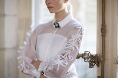 Details of our REANE Shirt in silk organza. The sleeves are created by Anne and her atelier, each tie has to be made then assembled one after the other to the model. White Blouses, Silk Organza, Virtual Closet, Searching, Artisan, Delicate, Ruffle Blouse, Tie, Embroidery