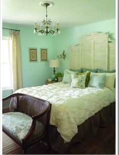 """As a headboard. A composition of shutters becomes a tall shabby-chic headboard in this bedroom. I especially love this look for a pair of twin beds, using old-fashioned cottage shutters"""""""