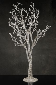 Silver Potted Trees 39 in..... This website has lots of cheap wedding decor!