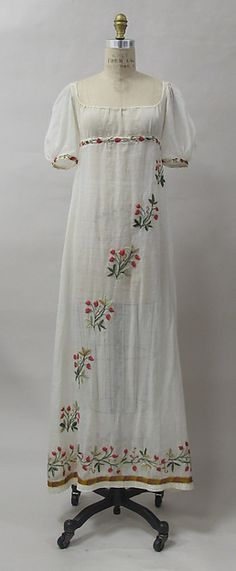 Crewel Embroidered Dress (front) ~ French ~  cotton, wool, metal ~ ca.1805 ~ This gown is believed to have belonged to the Comtesse de Pontèves-Bargème, née Marie Antoinette de Paul (1787-1854) who married Louis Balthasar Alexandre, Comte de Pontèves-Bargème (1781-1868) in 1804 ~ Musée des Arts Décoratifs ~ Metropolitan Museum of Art