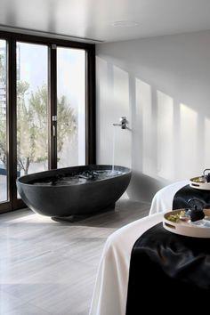 Black bath tub - minimalistic bathroom - Love the matte black bathtub , black framed windows , the simple & chic faucet fixture -  Expensive Home & Interior Design  - #Karinarussianpowpow