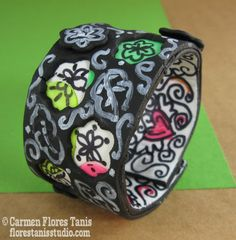 """Tutorial on using Makin's Clay to make my """"Kinda Sorta Wrap Clay Cuff"""" - I call it the """"Kinda Sorta"""" Cuff because it kind of reminds me of Dia del Los Muertos and Keith Haring but it's also sort of looks like a chalkboard or like leather. And it's also sort of stained glassy and licorice candylikey. Whatever it is, it was a lot of fun to make! Get directions here: http://florestanisstudio.typepad.com/bzzy_little_bee/2012/10/makins-clay-challenge-kinda-sorta-wrap-clay-cuff.html"""