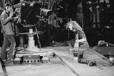 Guitarist Ritchie Blackmore performing for a TV camera during Deep Purple's performance at the California Jam rock festival, Ontario Motor Speedway, Ontario, California, 6th April 1974. Parts of the festival are being broadcast live on the ABC TV network.