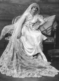 Bridal portrait, c. late 1910s. There has to be a story behind this.... she is wearing toe shoes (ballet) slippers...