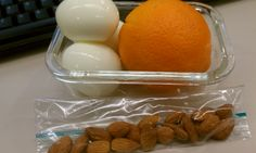 Whole30 Day Eight Lunch: Three boiled eggs, orange, and a handful of almonds.
