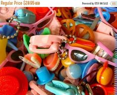 Vintage Cracker Jack Prizes Gumball Machine Toys Princess Phone Keychain, false teeth Misc Huge 24 Piece Lot, each lot contains, false teeth, princess phone, hot dog, hamburger, vintage rattle, hat, carousel and much more, however, colors will vary. This has to ship in a box so s/h will