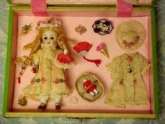 CELLULOID-PRESENTATION-BOX-WITH-CLOTHES-DOLL-ACCESSORIES-ANTIQUE-BISQUE-DOLL