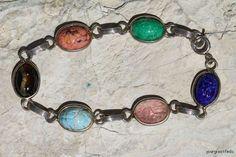 Vintage gold tone Czech glass Egyptian scarab beetle bracelet. $34.98, via Etsy.