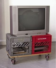 Milk crate TV stand with wheels. Great storage for game cube.  macgyver_tv