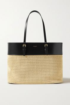 SAINT LAURENTs tote has been made in Italy from intricately woven raffia and contrasting black leather thats stamped with the logo. Its designed in a sizable silhouette that fits a bulky wallet, book and sunglasses case and has adjustable top handles and an internal slip pocket to organize smaller items.Shown here with: [SAINT LAURENT Cardigan id1210325], [SAINT LAURENT Tank id1210372], [SAINT LAURENT Jeans id1221786], [SAINT LAURENT Sandals id1210493].