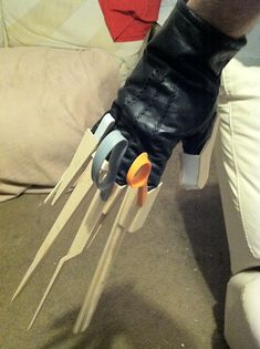 A near-screen-accurate replica costume prop of the gloves worn by Edward Scissorhands, made primarily of wood & foam.