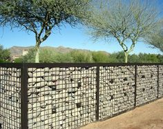 metal fence filled with rocks - Google Search