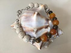 This uniquely handcrafted adjustable bracelet from Simply Charmed Jewelry has a nice mixture of warmth with the orange moonstone and tigers eye beads. The beige lava beads blend in nicely. The properties of these two gemstones work nicely together. The orange moonstone is the perfect stone for women Handmade Bracelets, Handcrafted Jewelry, Unique Jewelry, True Gift, Lava Bracelet, Tiger Eye Beads, Sparkly Jewelry, Healing Bracelets, Adjustable Bracelet