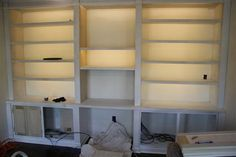 DIY inexpensive energy-efficient bookshelf lighting! All of these shelves lit for about $30! Full tutorial included.