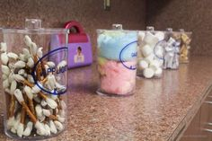 Pretzels as q-tips, cotton candy as gauze, marshmallows as cotton balls, & wafers as band-aids.. Use containers from work