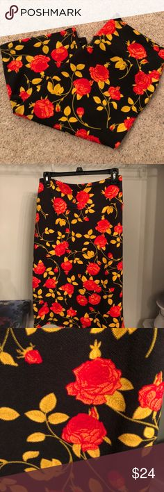 Lularoe Cassie worn once. Absolutely beautiful black, red roses with mustard/gold detailing. LuLaRoe Skirts Pencil