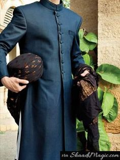 Junaid-jamshed navy blue sherwani. The darkest sky blue or you may call the navy blue is always on the list of groom and his wedding outfit. The color is so immense that any pattern, material, design and work on it can make you look charismatic for your very big day.