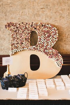Hubers Orchard and Winery wedding in Borden, Indiana. Used corks to fill initial, cute idea