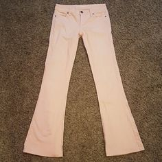 """Victoria's Secret Kitten Flare Denim Pants Pink 2 Victorias Secret kitten flare jeans gently used excellent condition. Salmon pink denim jeans.   Size 2 Long  32"""" inseam.  41"""" long  14"""" across waist, 28"""" waist circumference   Sold out and hard to find color and size. Black marks inside on VS KITTEN to prevent returns.   Jean material has no stretch. Zipper works great. All hardware intact. No rips snags stains or holes.   Will bundle with other VS kitten jeans for sale.  free gift with…"""
