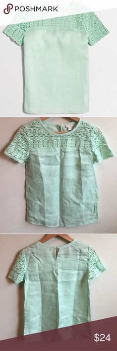 J Crew linen lace t-shirt This linen top has a lace crochet top. The material is lightweight and breathable, great condition, pretty mint green color! From the factory store J. Crew Factory Tops Blouses