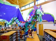 These lucky stuffies got to ride the library dragon Stuffed Animal Sleepover! These lucky stuffies got to ride the library dragon Lamb Nursery, Animal Nursery, School Displays, Library Displays, Book Displays, Kids Library, Library Ideas, Enchanted Forest Book, Pet Dragon