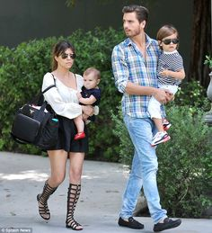 East to West: Scott was raised in Long Island with his parents but now lives in California with his partner Kourtney Kardashian and their two children Mason, aged four, and Penelope, aged one  Read more: http://www.dailymail.co.uk/tvshowbiz/article-2537462/Kourtney-Kardashian-Kris-Jenner-stand-grieving-Scott-Disicks-father-laid-rest.html#ixzz2q6mKGViZ  Follow us: @MailOnline on Twitter | DailyMail on Facebook