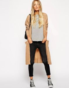 black high-top converse, black skinny ankle jeans, long beige cardigan, light grey tee