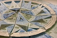 This impeccably crafted book unfolds to reveal an enormous 3D compass