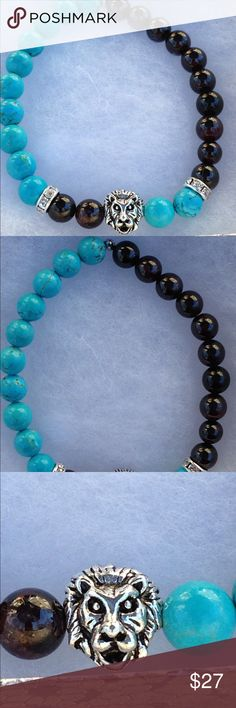 "Turquoise Magnesite Red Garnet Lion Head Bracelet This unique bracelet is made with natural turquoise magnesite and sangria red garnet. The lion is silver tone. This piece is on elastic and will stretch to fit up to an 8"" wrist.   All PeaceFrog jewelry items are handmade by me! Take a look through my boutique for coordinating jewelry and more unique creations. PeaceFrog Jewelry Bracelets"