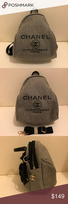"""Chanel VIP gift Backpack Cross Body Bag Gray Authentic Chanel VIP gift Canvas Backpack Cross Body Bag. Gray, Gold Hardware. Brand new with original packaging bag. Form a Chanel Flagship store in Asia. no hologram sticker or authenticity card for gifts. Approximately 12"""" x 10"""" x 5"""" inches. with an extra strap for cross body. CHANEL Bags Backpacks"""