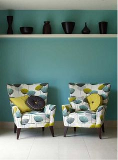 Aqua Green wallpaper / White Shelf / Black Vases - Wonder if the hubs would give up a new recliner for one of these...