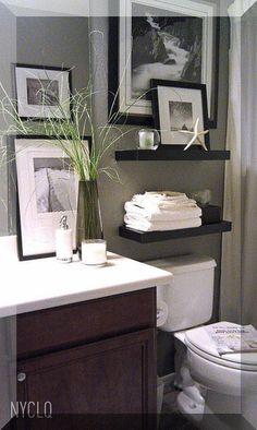 Bathroom Decor Inspiration- Shelves over master bathroom toilet for storage. I like the black and white prints.