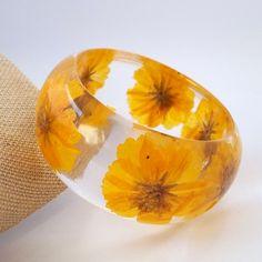 Yellow Resin Bangle. Chunky Resin Bangle Bracelet. Pressed Flower Bracelet. Real Flowers - Yellow Cosmos. $44.00, via Etsy.